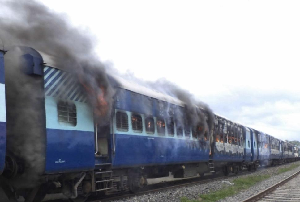 MOB SETS FIRE TO TRAIN ENGINE AFTER ACCIDENT