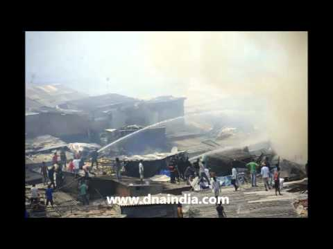 FOUR OF FAMILY KILLED IN FIRE AT SLUM