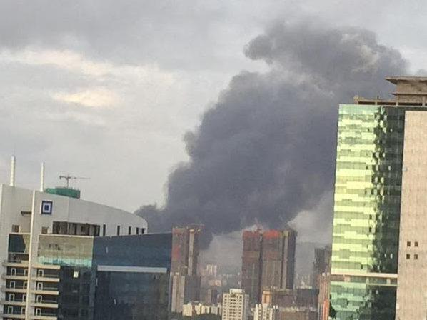 An image provided by a resident of Wadala shows thick smoke billowing out of Mumbai Port Trust on Saturday.