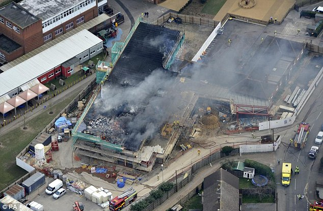 BREAKING NEWS Scores of firefighters tackle huge fire at £12,000-a-year primary school after explosion